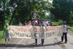 """Marchers on the main Road through the Bajo Lempa - their banner reads, """"March for True Independence for the People."""""""